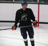 Jeff Petry stands in a faceoff circle during a session of the 2013 MSU Pro Camp.