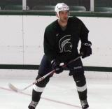 Mike Weaver skates in his own zone during a session of the 2013 MSU Pro Camp.