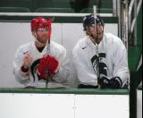 Daniel Cleary and Chris Mueller sit on the bench during a session of the 2013 MSU Pro Camp.