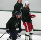 Mike Merrifield and Jakub Kindl skate along the boards during a session of the 2013 MSU Pro Camp.