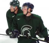 Chris Forfar and Mike Merrifield stand on the ice during a session of the 2013 MSU Pro Camp.