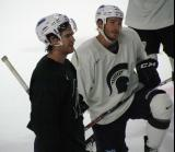 Jim Slater and Zach Redmond stand on the ice during a session of the 2013 MSU Pro Camp.