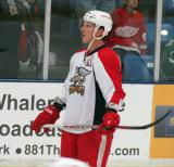 Brennan Evans stands near the boards during pre-game warmups before a Grand Rapids Griffins preseason game.