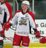 Brennan Evans looks at the scoreboard during pre-game warmups before a Grand Rapids Griffins preseason game.