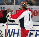 Cam Lanigan gets a skate worked on at the bench during pre-game warmups before a Grand Rapids Griffins preseason game.
