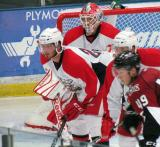 Gleason Fournier lines up for a faceoff in front of goalie Tom McCollum during a Grand Rapids Griffins preseason game.