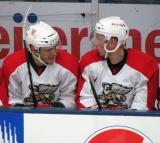 Martin Frk and Marek Tvrdon talk on the bench during a Grand Rapids Griffins preseason game.