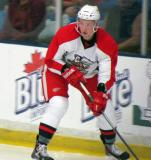 Marek Tvrdon skates along the boards during a Grand Rapids Griffins preseason game.