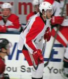 Trevor Parkes skates in front of the bench during a Grand Rapids Griffins preseason game.