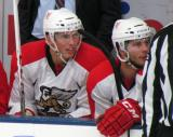 Richard Nedomlel and Gleason Fournier sit on the bench during a Grand Rapids Griffins preseason game.