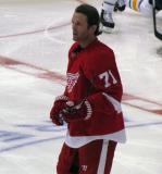 Daniel Cleary stands at center ice during pre-game warmups.