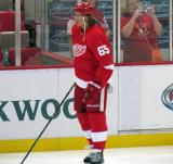 Danny DeKeyser stands along the boards during pre-game warmups.
