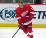 Daniel Alfredsson skates with the puck during pre-game warmups.