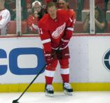 Daniel Alfredsson stands at the boards during pre-game warmups.