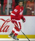 Henrik Zetterberg skates along the boards during pre-game warmups.