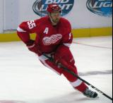 Niklas Kronwall skates in the neutral zone during pre-game warmups.