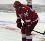 Stephen Weiss crouches at center ice during pre-game warmups.