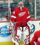 Petr Mrazek stands along the boards during pre-game warmups.