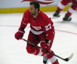 Kyle Quincey skates in the left faceoff circle during pre-game warmups.