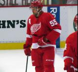 Niklas Kronwall stands at the blue line during pre-game warmups.