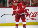 Mikael Samuelsson crouches near the boards during pre-game warmups.