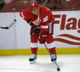 Stephen Weiss crouches near the boards during pre-game warmups.