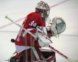 Petr Mrazek knocks aside a puck during pre-game warmups.