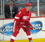 Brendan Smith stands at the boards during pre-game warmups.