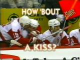 The infamous 'Kiss in Columbus,' Steve Yzerman plants one on Martin Lapointe's cheek as Brendan Shanahan laughs.
