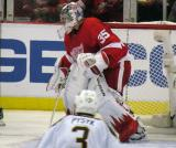 Jimmy Howard watches play move into the corner to his right.