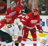 Henrik Zetterberg and Jonathan Ericsson get set for a faceoff opposite Buffalo's Thomas Vanek, in front of Detroit goalie Jimmy Howard.