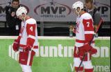 Nathan Paetsch and Ryan Sproul stand at the bench during pre-game warmups before a Grand Rapids Griffins game.
