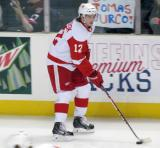 Calle Jarnkrok skates with a puck during pre-game warmups before a Grand Rapids Griffins game.