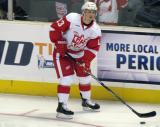 Gustav Nyquist carries a puck along the boards during pre-game warmups before a Grand Rapids Griffins game.