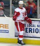 Teemu Pulkkinen stands at the boards during pre-game warmups before a Grand Rapids Griffins game.