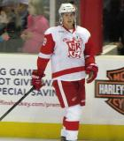 Cory Emmerton skates at the boards during pre-game warmups before a Grand Rapids Griffins game.