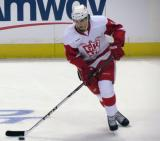 Alexey Marchenko carries a puck in the neutral zone during pre-game warmups before a Grand Rapids Griffins game.