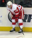 Tomas Jurco crouches along the boards during pre-game warmups before a Grand Rapids Griffins game.