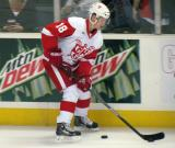 Cory Emmerton carries a puck along the boards during pre-game warmups before a Grand Rapids Griffins game.