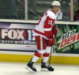 Mitch Callahan skates along the boards during pre-game warmups before a Grand Rapids Griffins game.