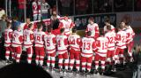 The Grand Rapids Griffins surround the banner honoring their 2013 Calder Cup Championship prior to it being raised at Van Andel Arena.