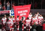 The Grand Rapids Griffins surround the banner honoring their 2013 Calder Cup Championship as it's raised at Van Andel Arena.