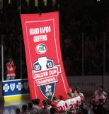 The Grand Rapids Griffins unfurl the banner honoring their 2013 Calder Cup Championship prior to it being raised at Van Andel Arena.