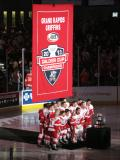 The Grand Rapids Griffins pose with the Calder Cup and the banner honoring their 2013 championship before the banner is raised at Van Andel Arena.