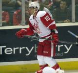 Jeff Hoggan skates back to the bench during a stop in play in a Grand Rapids Griffins game.