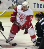 Darren Helm takes a faceoff during a Grand Rapids Griffins game.