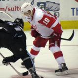 Cory Emmerton gets set to take a faceoff during a Grand Rapids Griffins game.