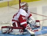 Petr Mrazek stretches in his crease at the start of the third period of a Grand Rapids Griffins game.