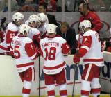 The Grand Rapids Griffins huddle around coach Jeff Blashill during a late-game timeout.