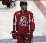Luke Glendening stands at center ice during pre-game warmups before a Grand Rapids Griffins game.